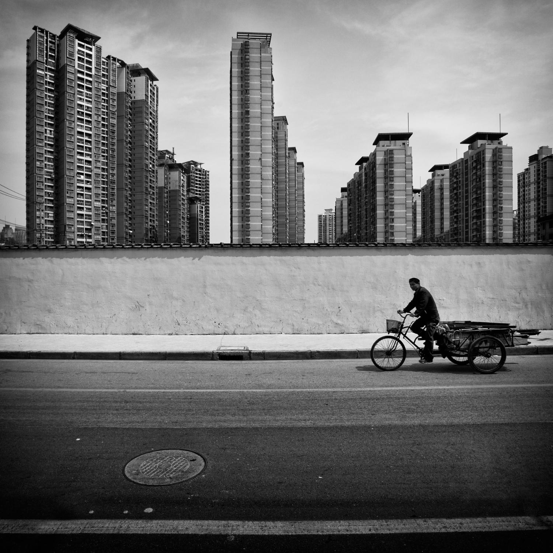 Fotowettbewerb Kontraste - Fahrradfahrer Shanghai